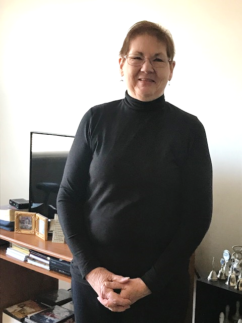 Photo of a wmoan in a black long sleeve shirt